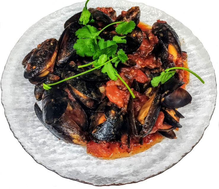 Черноморские мидии  в томатном соусе